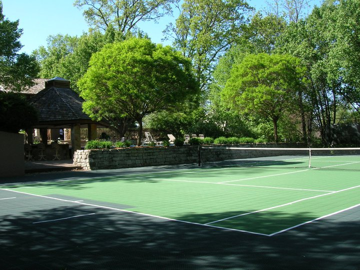 Low-maintenance backyard tennis court